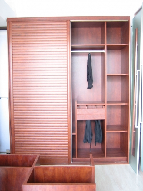 Free Standing Wardrobe Brown Wooden Wardrobe With Many Shelves Combined With Large Door Bedroom Closets Pic 33
