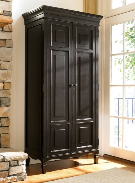 Black Wardrobe Armoire Decoration Brick Wall Interior Design In Small Room With Black Photo
