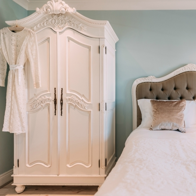 N72 White Chic Bedroom In White Comfort Bed With Small Armoire Wardrobe Also Square Brown Pillow Picture